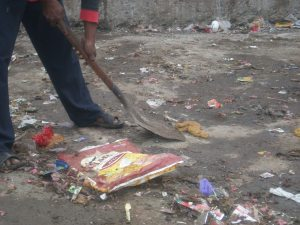 A manual scavenger cleans up night soil in Ahmedabad without any protective equipment
