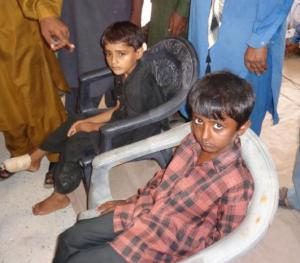 Injured children as a result of the cracks in a school building in Kutch