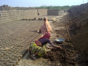 women making bricks