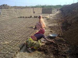 women making bricks