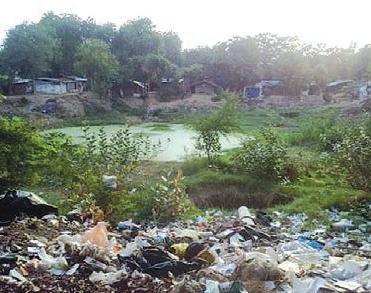 Dumping of biomedical waste near the pond, community health centre, Savli, Vadodara