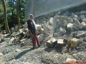 A member of the Dalit family overlooking the destroyed house