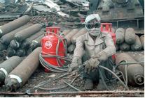 A migrant worker at work at Alang Shipyard