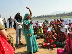 Villagers protest against Garudeshwar Dam next to the Narmada river