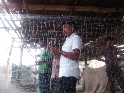 A Chorwad fisherman preparing his net before going to the sea