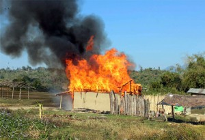 A house set on fire during  attacks by NDFB (S) militants in Assam