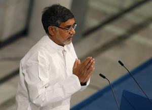 Nobel Peace Prize laureate Kailash Satyarthi reacts after delivering his speech during the Nobel Peace Prize awards ceremony at the City Hall in Oslo on December 10, 2014