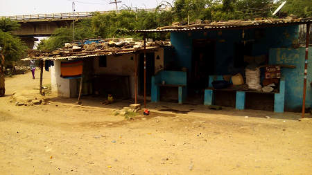 These houses at Khalghat village are  below the marked high water levels, but families are not recognized as project affected