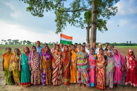 The villagers of Salaha stand in front of their land, flying the Indian flag proudly as a reminder of their triumph