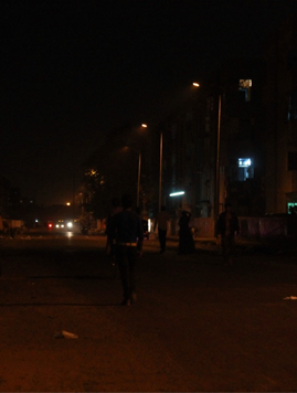Dimply lit street along one side of VGG Nagar and KBT Nagar