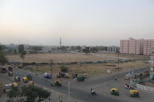 Vacant, undeveloped land at the main cross-roads between VGG Nagar and Sadbhavna Nagar