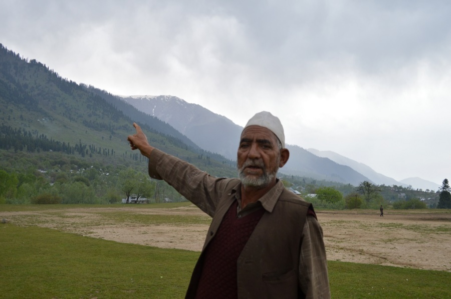 A-Kashmiri-man-near-a-Budgam-forest-shows-the-degradation-caused-to-firests-over-the-past-few-decades-Photo-__-Athar-Parvaiz-