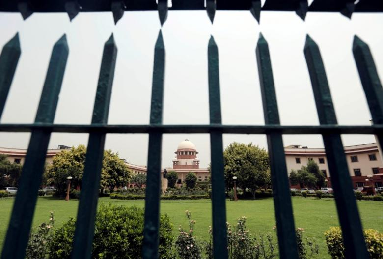 India's Supreme Court is pictured through a gate in New Delhi