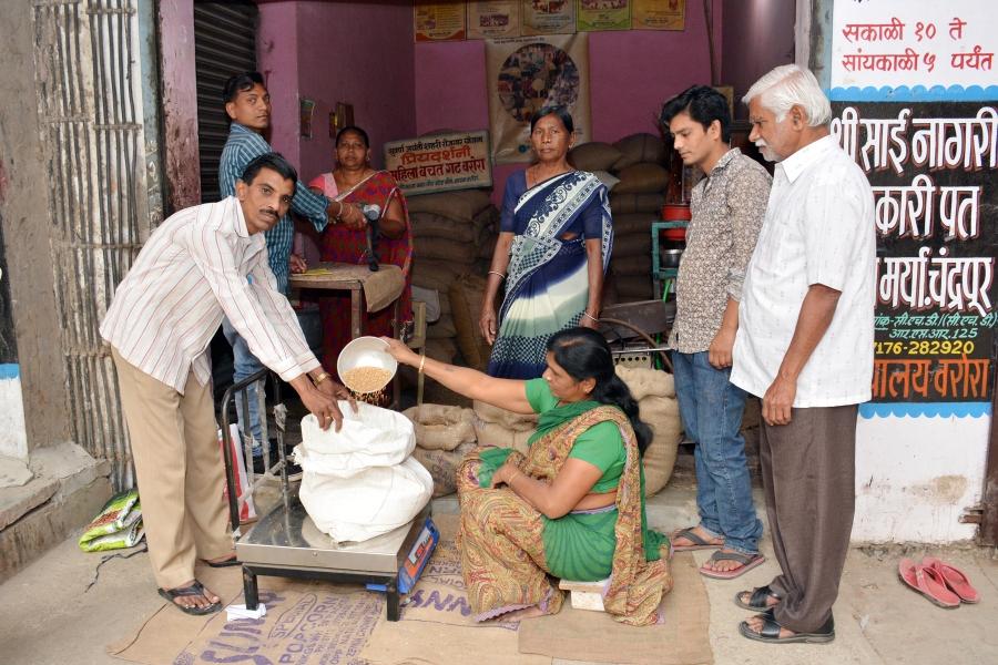 Shashikala Narole serves a customer watched by Minakshi Wankhede and Zaibun